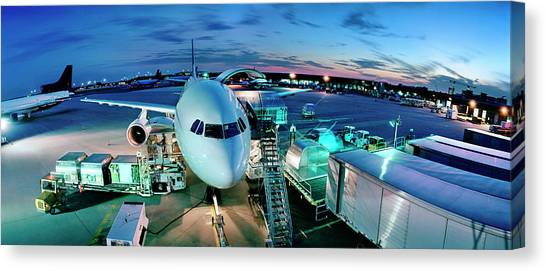 Cargo Plane Being Loaded At Night Canvas Print