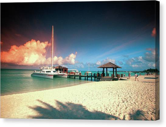 Catamaran Docked At Pier At Sunset On Canvas Print
