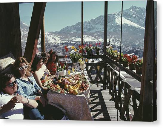 Catching The Sun In Cortina Canvas Print by Slim Aarons