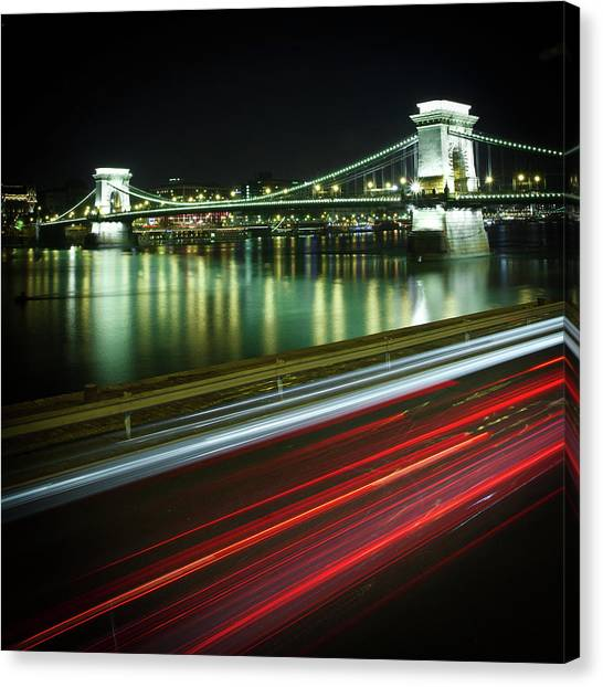 Chain Bridge At Night In Budapest Canvas Print by Mark Whitaker