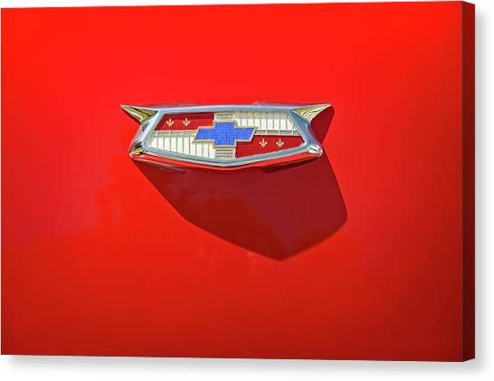 Old Truck Canvas Print - Chevrolet Emblem On A 55 Chevy Trunk by Scott Norris