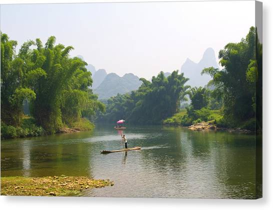 Chinese Man In Bamboo Raft At Yulong Canvas Print