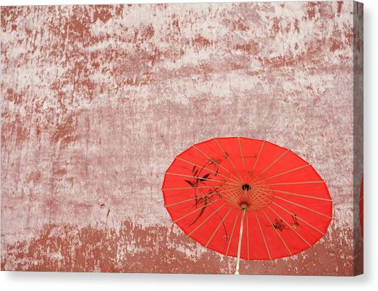 Chinese Parasol Against A Textured Wall Canvas Print