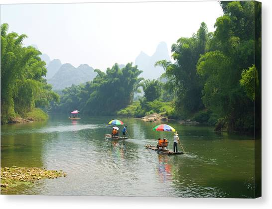 Chinese Tourists In Bamboo Rafts At Canvas Print