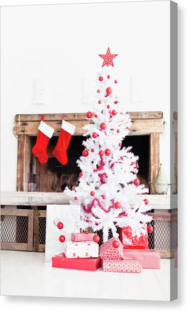 1c50f8df55d White Stockings Canvas Print - Christmas Tree With Gifts And Stockings by  Hybrid Images