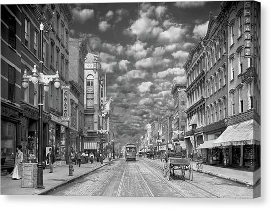 Canvas Print featuring the photograph City - Ny - Main Street Poughkeepsie, Ny - 1906 - Black And White by Mike Savad