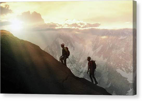 Climbers On A Mountain Ridge Canvas Print by Buena Vista Images