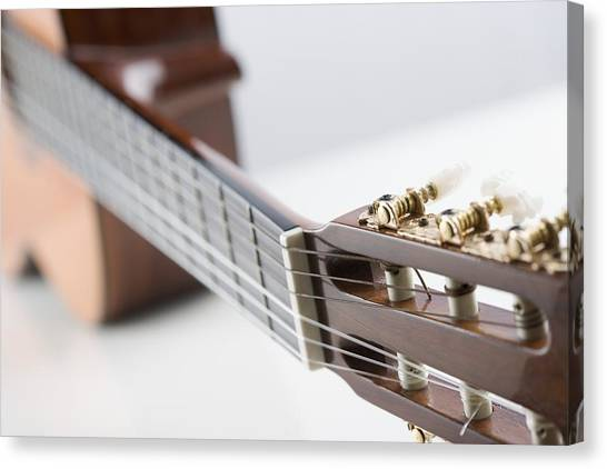 Close-up Of A Guitar Canvas Print by Jamie Grill