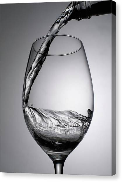 Close Up Of Wine Being Poured Into Wine Canvas Print by Johner Images
