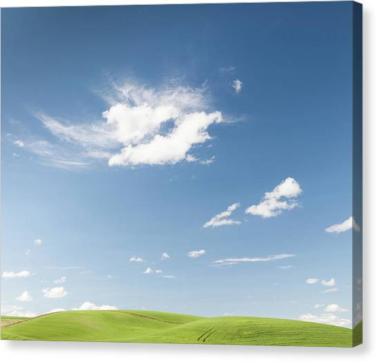 Clouds Over Green Hills Canvas Print by Adrian Studer