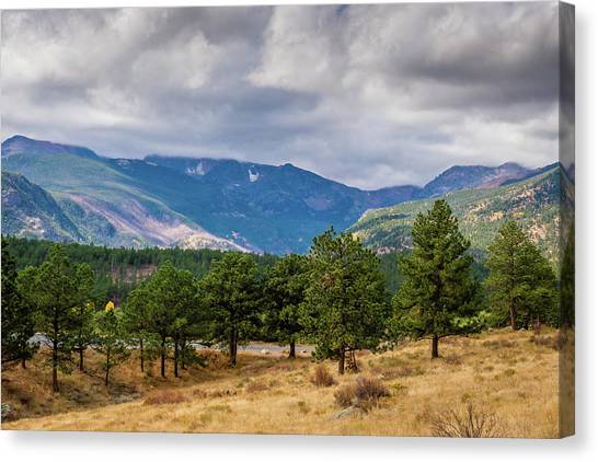 Canvas Print featuring the photograph Clouds Over The Rockies by James L Bartlett