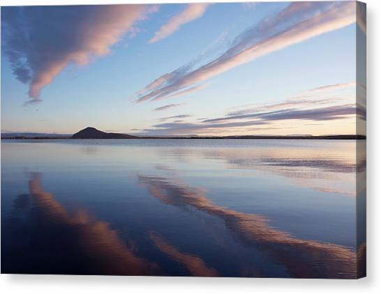 Bishop Hill Canvas Print - Clouds Reflected In Lake Myvatn by Sue Bishop