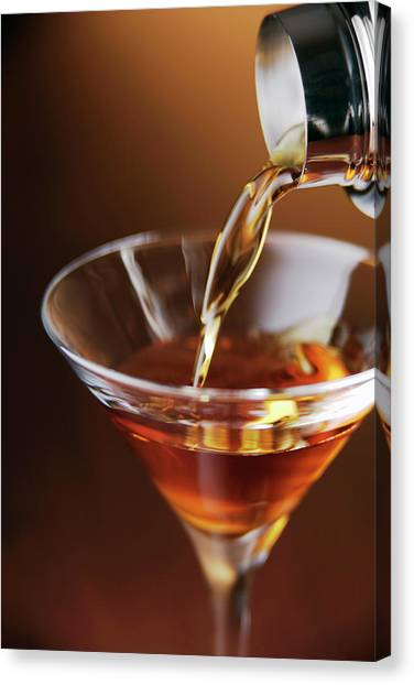 Cocktail Pouring Into Glass Canvas Print