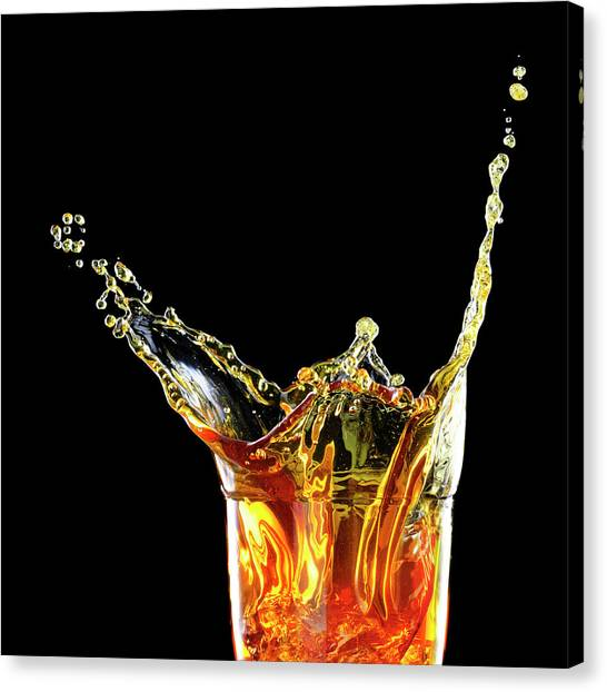Cocktail With Big Splash In A Tumbler Canvas Print by Chris Stein