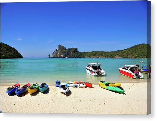 Colorful Canoes On Beach Canvas Print by Aaron Geddes Photography