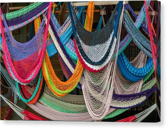 Colorful Hammocks Canvas Print by Philippe Marion