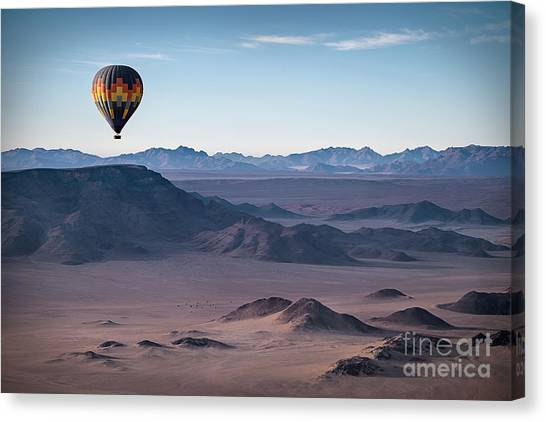 Basket Canvas Print - Colorful Hot-air Balloon Flying Over by Liz Glasco