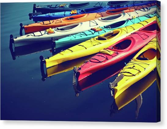 Colorful Kayaks Canvas Print by Kyle Igarashi