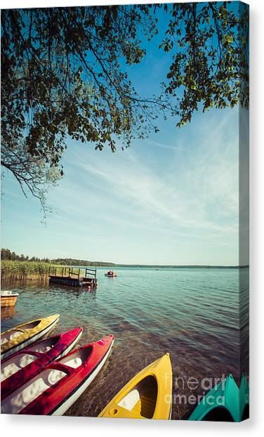 Canoe Canvas Print - Colorful Kayaks Moored On Lakeshore by Curioso