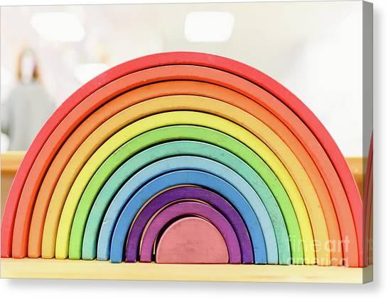 Colorful Waldorf Wooden Rainbow In A Montessori Teaching Pedagogy Classroom. Canvas Print