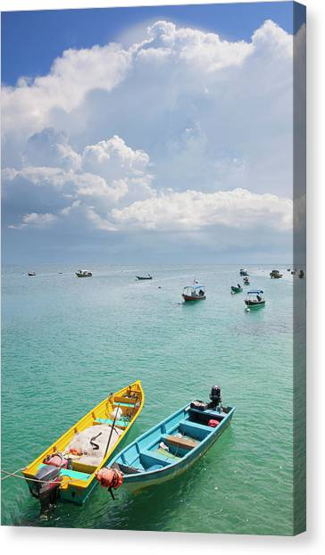 Colourful Boats Moored Storm Clouds Out Canvas Print