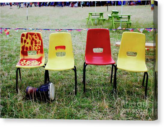 Djembe Canvas Print - Colourful Plastic Chairs by Tom Gowanlock