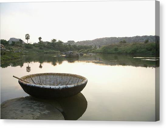 Coracle At The Bank Of A River Canvas Print by Exotica.im