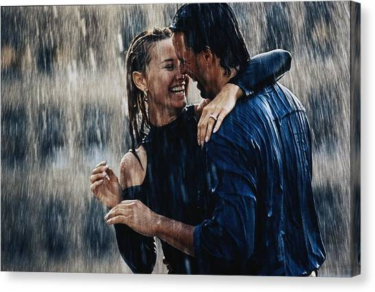 Couple Embracing In Pouring Rain Canvas Print by Bruce Ayres