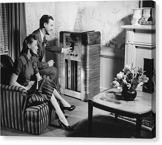 Couple Listening To Radio In Living Canvas Print