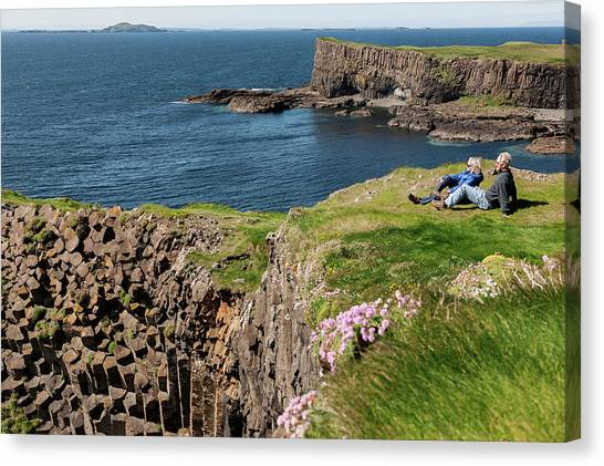 Couple Relaxing In Grass On Cliff Canvas Print