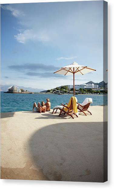 Couple Sunbathing On The Terrace Of The Canvas Print