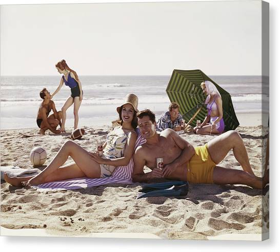 Couples Having Fun On Beach, Smiling Canvas Print