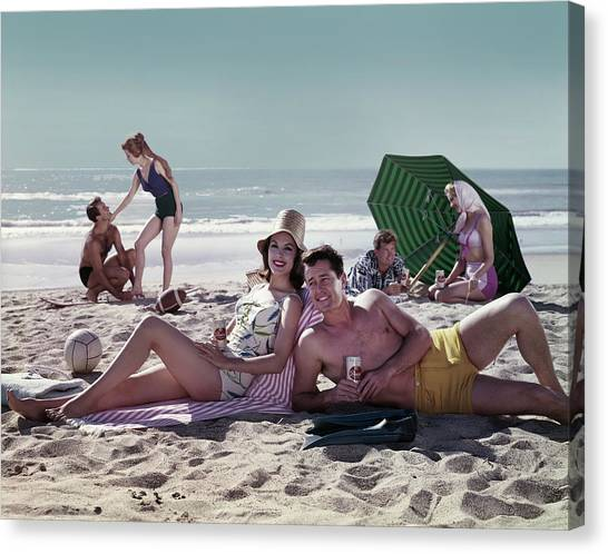 Couples On The Beach Canvas Print by Tom Kelley Archive
