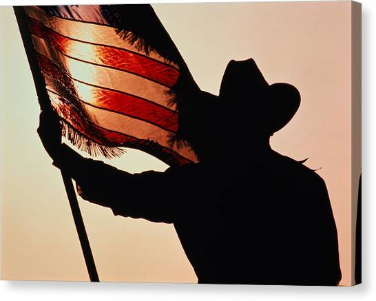 Casual Canvas Print - Cowboy Holding Stars And Stripes by Donovan Reese