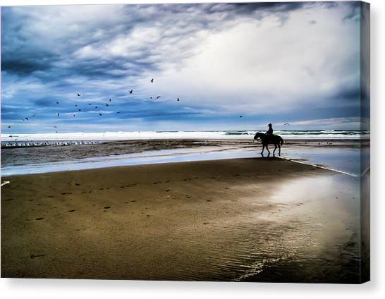 Cowboy Riding Horse On Beach Canvas Print