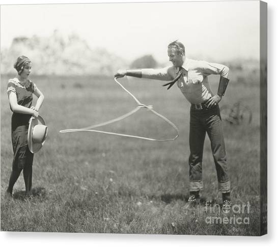 Cowboy Canvas Print - Cowboy Showing Off His Roping Skills by Everett Collection