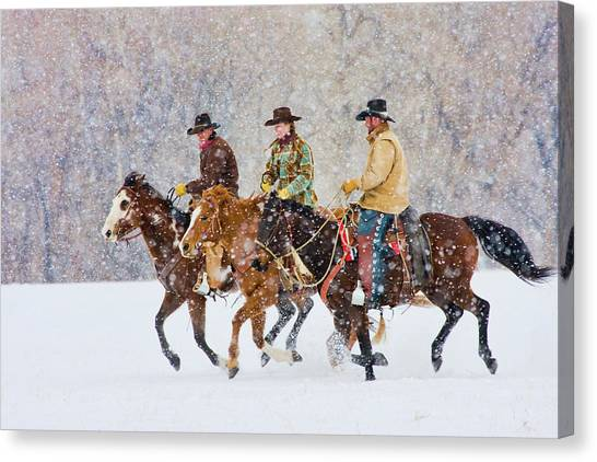 Cowboys And Cowgirl Riding Snowfall Canvas Print by Danita Delimont