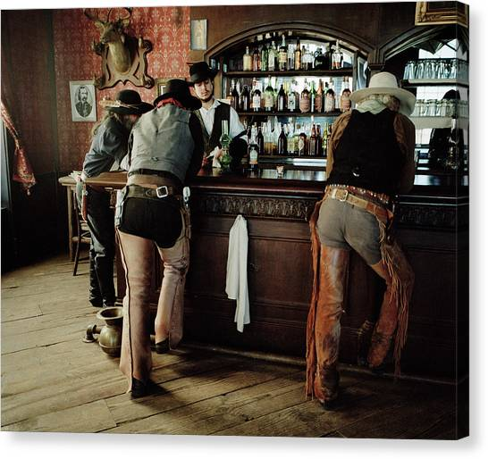 Casual Canvas Print - Cowboys At Saloon by Matthias Clamer