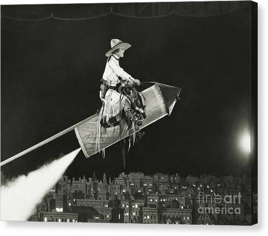 Performing Canvas Print - Cowgirl Takes Off On A Rocket by Everett Collection
