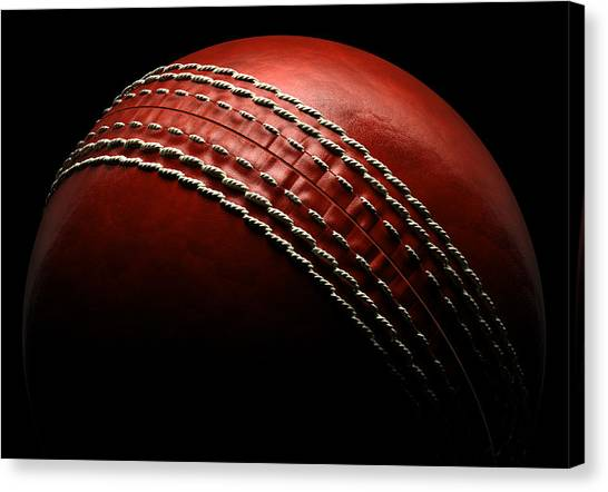 Cricket Ball On Black Background Canvas Print by Ian Mckinnell