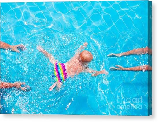 Exercising Canvas Print - Cute Little Baby Swimming Underwater by Famveld