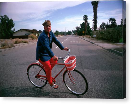Cycling Capote Canvas Print by Slim Aarons