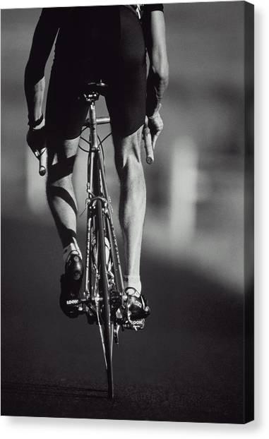 Cyclist On Road, Rear View B&w Canvas Print