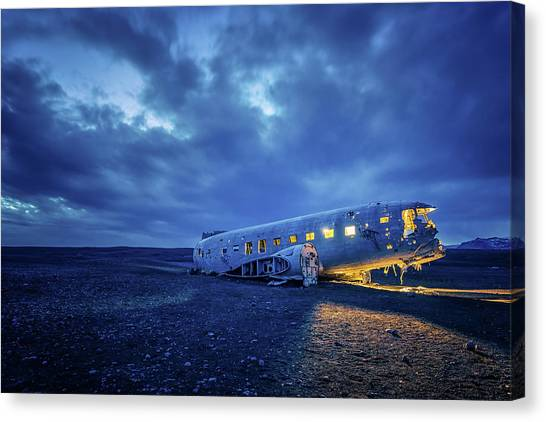 Canvas Print featuring the photograph Dc-3 Plane Wreck Illuminated Night Iceland by Nathan Bush