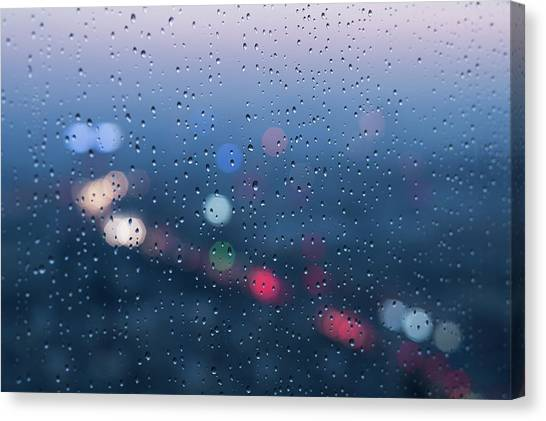 Defocused Lights And Water Droplets On Canvas Print by Miragec