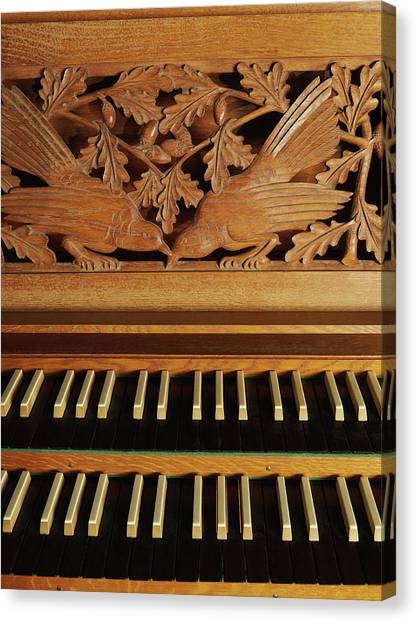 Detail Of A Pipe Organ With A Wooden Canvas Print by Hudzilla