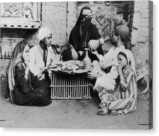 Dinner In Egypt Canvas Print by Hulton Archive