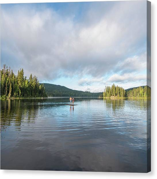 Distant People Float On Wooden Raft, On Canvas Print