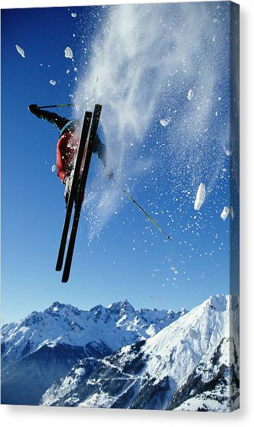 Downhill Skier In Mid-air, Rear View Canvas Print