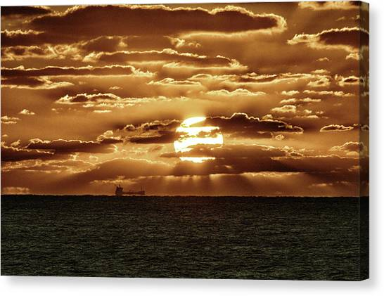 Canvas Print featuring the photograph Dramatic Atlantic Sunrise With Ghost Freighter In Goldtone by Bill Swartwout Fine Art Photography